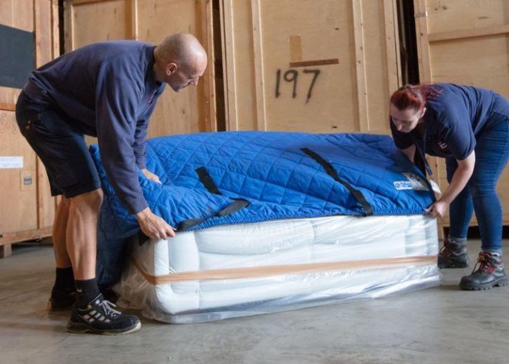 ballards-staff-packing-a-sofa_736_527_80_s_c1