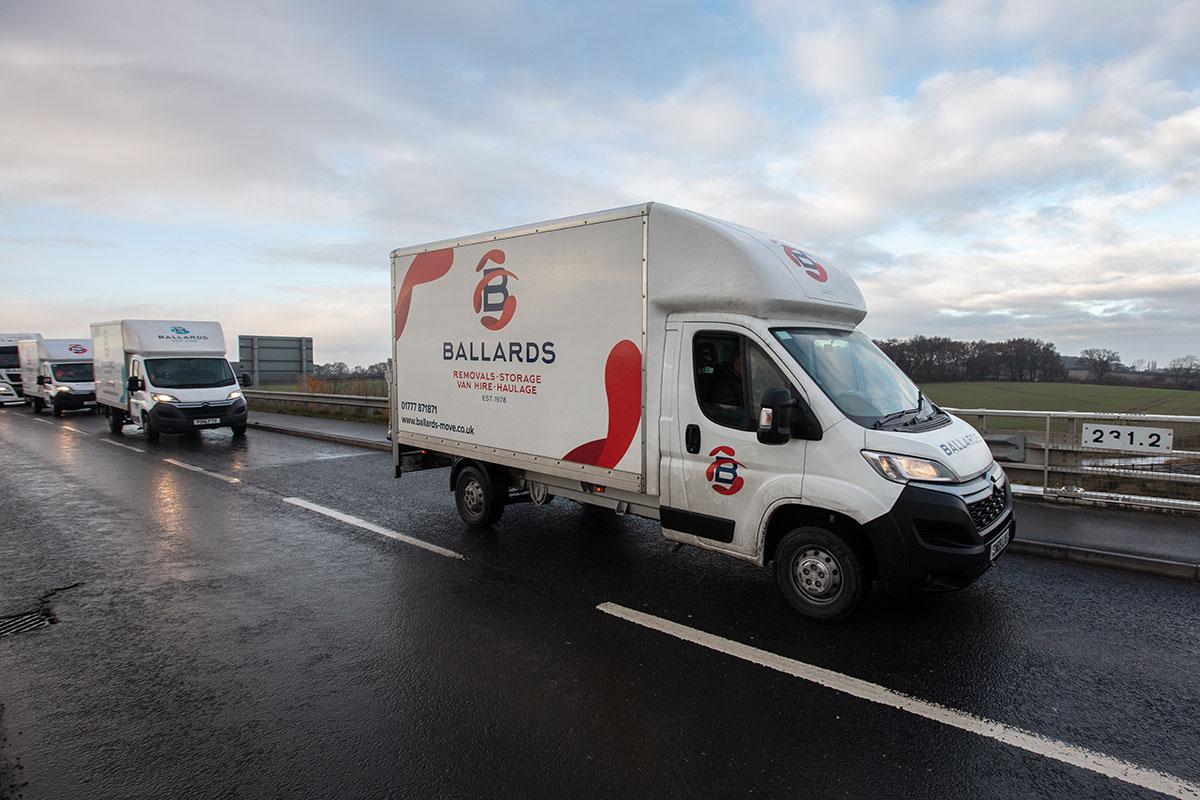 ballards-removal-vans-on-road